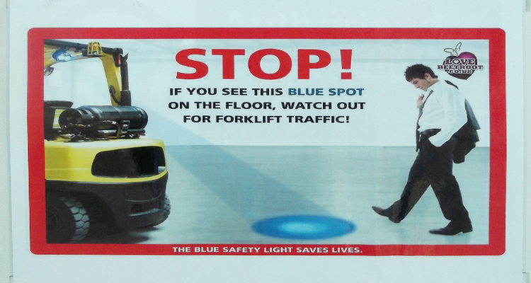 Blue spot warning system for forklift trucks